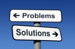 Signpost pointing to problems and solutions.