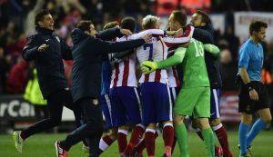 les-joueurs-de-l-atletico-madrid-fetent-leur-qualification-pour-les-quarts-de-finale-de-la-ligue-des-champions-obtenue-face-au-bayer-leverkusen-le-17-mars-2015-a-madrid_5303297